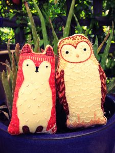 Foxie and owl enjoy the garden